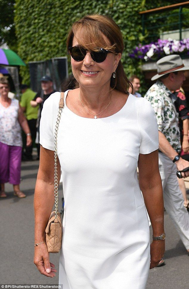 Carole, 62, showed off her very youthful figure and glowing tan in a white dress as she arrived at SW19 with her husband Michael, who looked dapper in a navy suit and striped shirt.