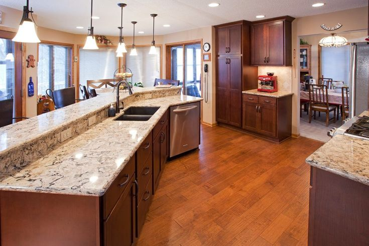 cambria bellingham kitchen traditional with 3 level island transitional wall clocks