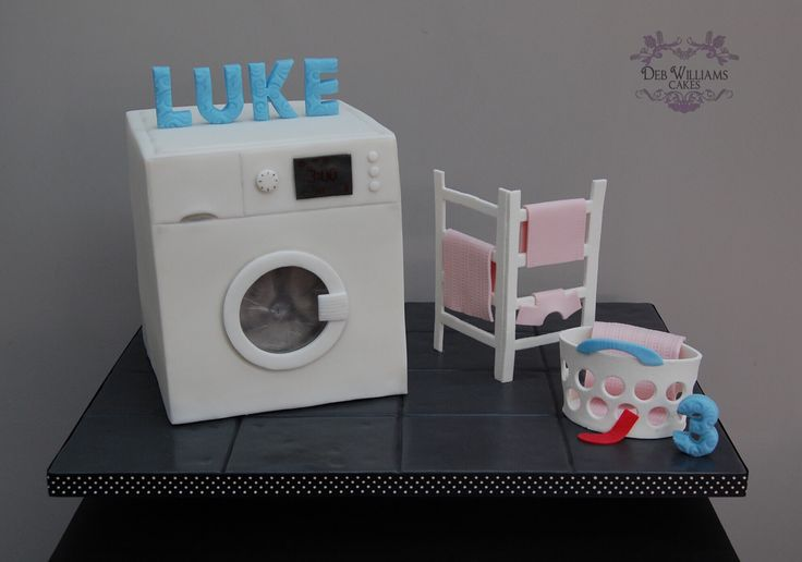 That pesky red sock, it's turned all my washing pink! A washing machine cake by Deb Williams Cakes