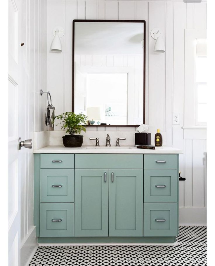 """""""I have been obsessed with this gorgeous bathroom design from @cortneybishopdesign. Farrow and Ball #84 (blue green) is perfection on this vanity. Makes me…"""""""