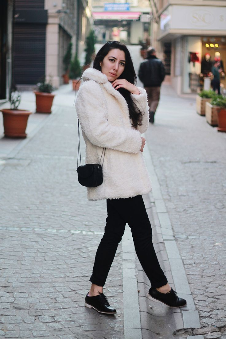 A white textured coat and black chinos are a great outfit formula to have in your arsenal. For footwear go down the classic route with black leather oxford shoes.  Shop this look for $78:  http://lookastic.com/women/looks/white-coat-black-crossbody-bag-black-chinos-black-oxford-shoes/7298  — White Textured Coat  — Black Suede Crossbody Bag  — Black Chinos  — Black Leather Oxford Shoes