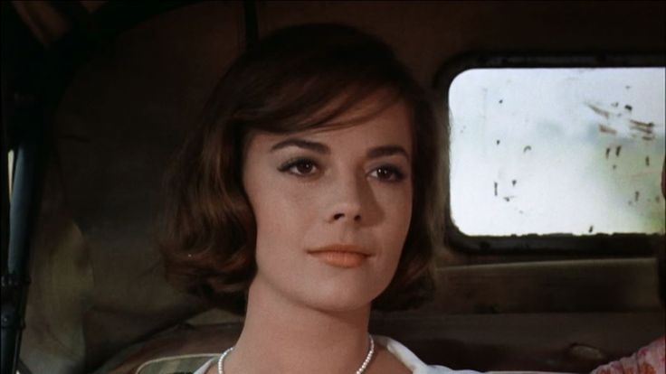 """The last image of Natalie Woods in Splendor in the Grass 1961 as Deanie's voice is heard reciting the lines from William Wordsworth's poem """"Ode: Intimations of Immortality from Recollections of Early Childhood"""": What though the radiance which was once so bright Be now for ever taken from my sight, Though nothing can bring back the hour Of splendour in the grass, of glory in the flower; We will grieve not, rather find Strength in what remains behind."""