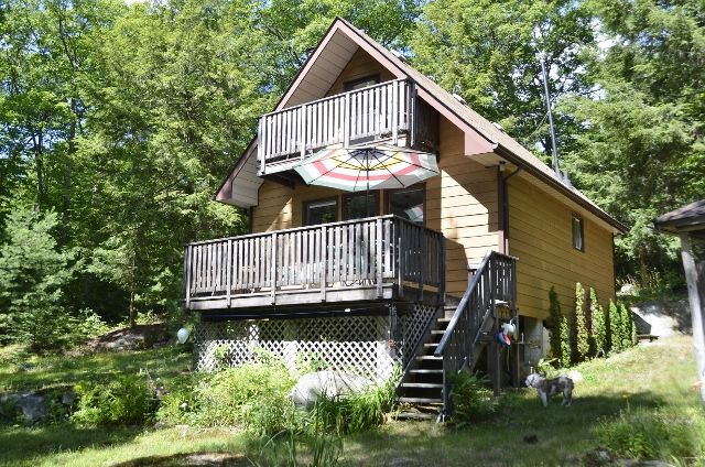 ANOTHER SOLD! This private, 3 bedroom off the grid cottage is the perfect wilderness retreat. Comforts are taken care of with a solar panel, wood stove, compost toilet with exterior tank and propane fridge and stove.  Recent updates: new dock (2010), new shed (2015), new shingles (2014) and new pump at the lake (2016). Southern exposure, gentle slope to shore, 2 hours from the GTA, Burnt Lake is a no motor lake, few cottages and most of the lake is crown land.329.16A $319,000