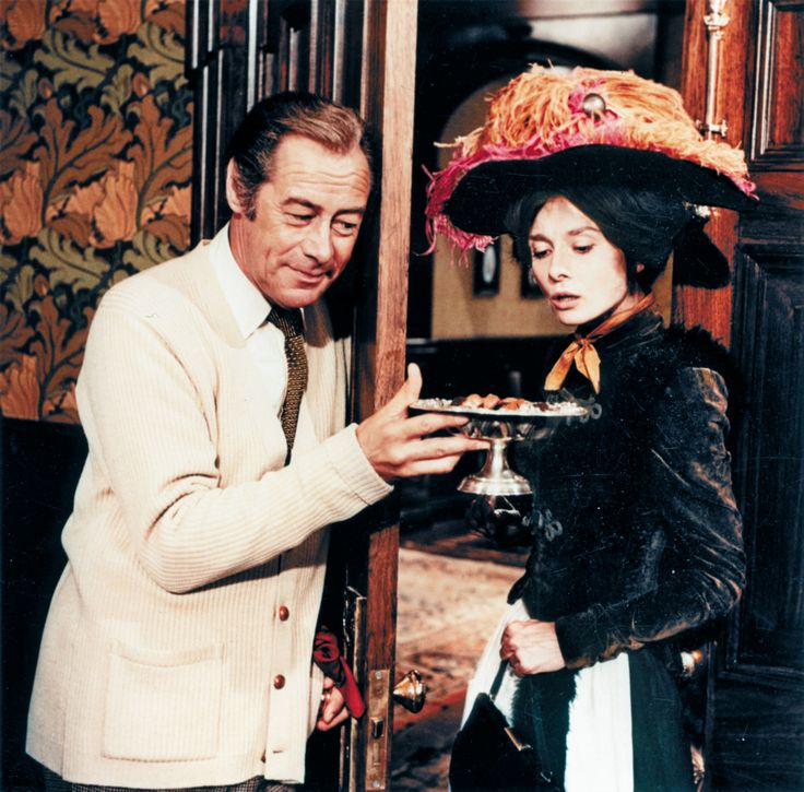 My Fair Lady | Rex and Audrey in My fair Lady   Higgins tempts Eliza to stay   when she threatens to leave.   BW