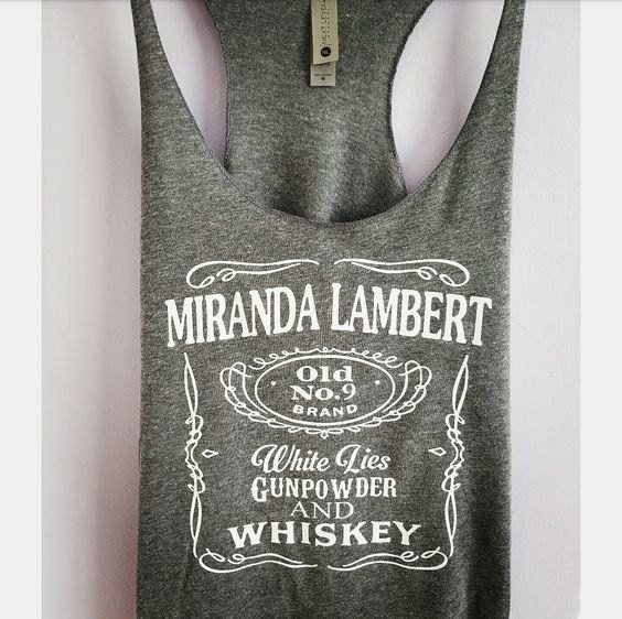 Miranda Lambert whiskey print on a triblend, racerback tank top. These tanks are a mix of cotton and poly, making them super soft and light. This is a relaxed-fit tank that runs true to size (womens).