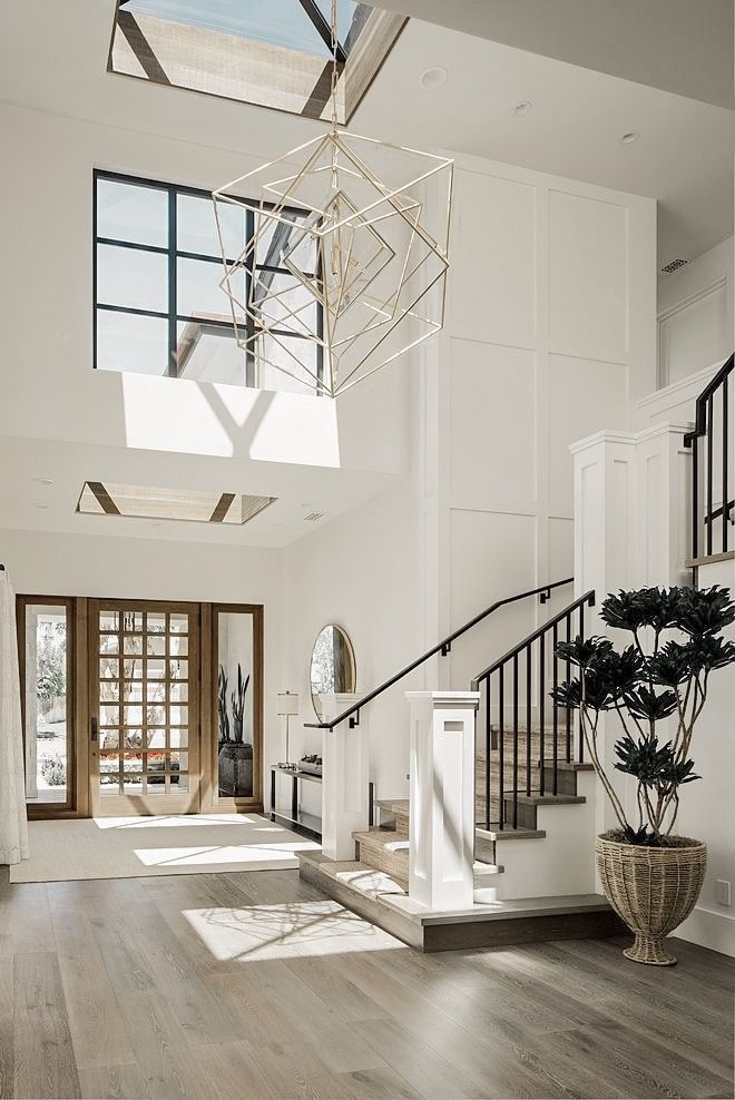 The white walls and black railing and accents give the space ... on friends home design, summer home design, google home design, apple home design, outdoor seating restaurants design, interior design, design home design, self-sustaining home design, future home design, quotes about home design, bobby mcalpine home design, cottage style home design, houzz home design, cat home design, good home design, family home design, clubhouse architecture design, inside restaurant design, search home design,