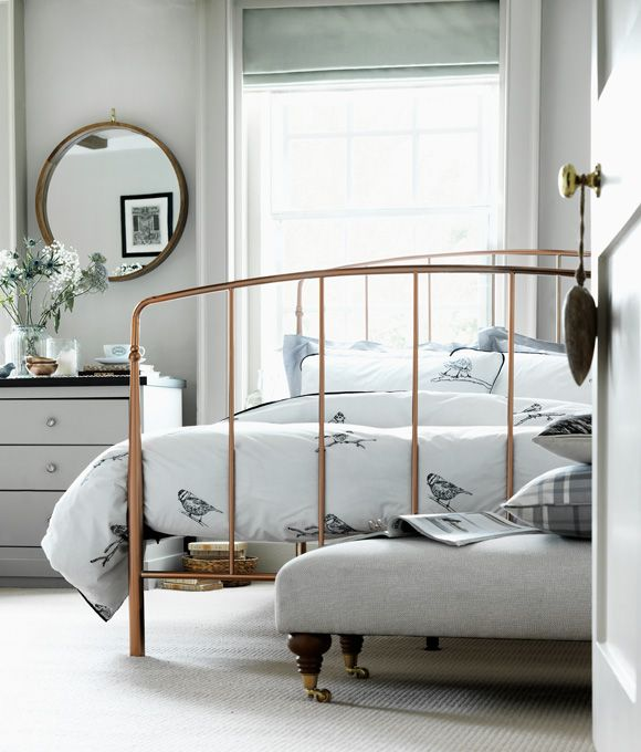 Home Inspiration Bedroom furniture Ideas. Rustic bedroom with copper bed frame and bird pattern bedding.
