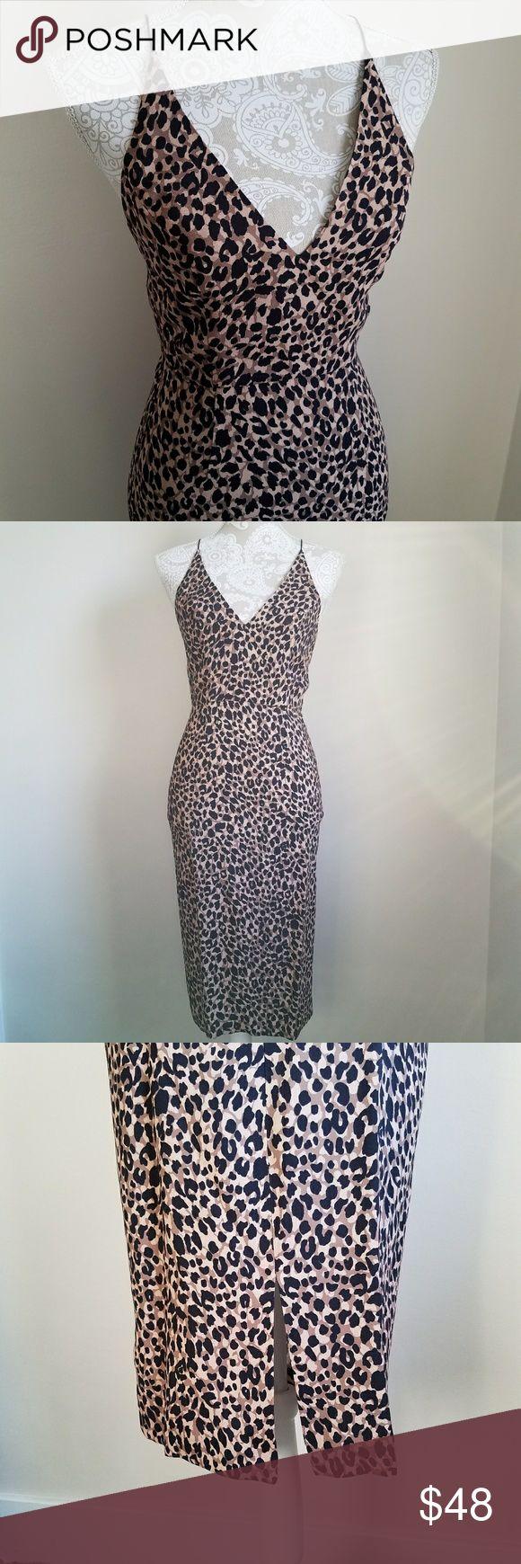"TOPSHOP   animal print bodycon dress Cheetah print dress. Thin criss cross straps. Hidden zipper closure. Slit back of dress, about knee length.  US 2, UK 6 Length: 42"" Armpit-Armpit: 15.5"" *measurements are approximate* Topshop Dresses Midi"