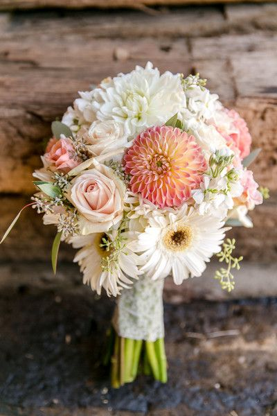 Pink, ivory, cream, and blush flower summer wedding bouquet idea - shades of pink wedding bouquet - dahlias, Gerber daisies, roses, and stock tied with lace {Leah Marie Photography}
