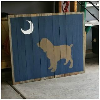 Boykin Spaniel under Palmetto Moon sign on reclaimed wood.  DIY instructions listed in the post.  Could use instructions to make any silhouette sign.  | The Lowcountry Lady