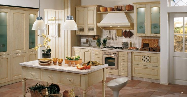 This luxurious kitchen design features high ceilings, wood beams, and country French kitchen cabinets in a hand-distressed antique white crackle finish.