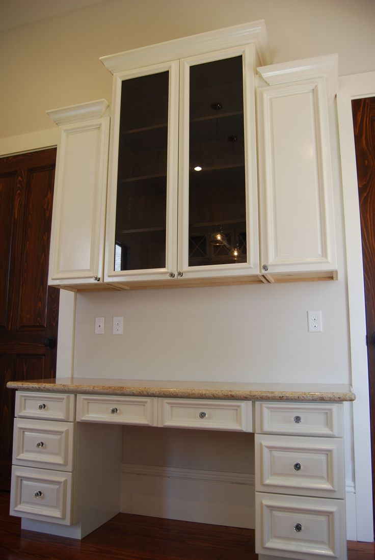 Custom designed and built desk & wall cabinets in kitchen