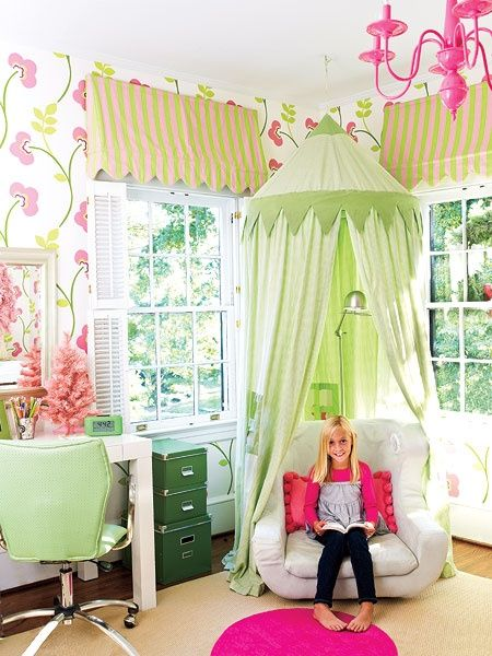Girls Pink Retreat  This cheery girls bedroom in Charlotte, North Carolina, was inspired by its graphic floral wallpaper. The pink-and-green color scheme is found in the bedding and fabrics and punctuated with a hot pink chandelier and green desk accessories. Awning valances.