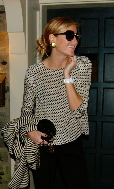 Black, white, oversized sunglasses, perfect bun