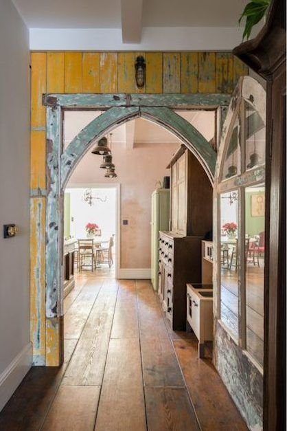 Salvaged Wood Paneling And Church Archway In A Renovated London Victorian House
