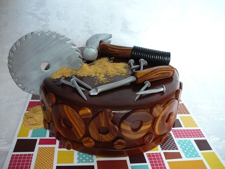 My fourth woodwork cake for a 60 years old man who loves to do woodwork. I try to improve me design each time I repeat the same cake. I am happy with the tools wood this time, I think it looks real wood. This is a chocolate cake with chocolate ganache filling covered with fondant. All the tools and details are fondant. I used silver luster dust on the saw and on the other tools. The sawdust is graham cookies.