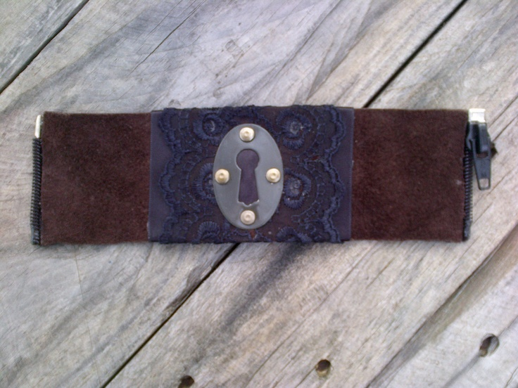 'Arcana' cuff  Brown leather (fuzzy side up)  Charcoal satin ribbon  Black lace  Black keyhole cover  Antique-tinted rivets