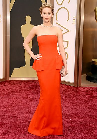 Jennifer Lawrence in Dior Haute Couture at 2014 Oscars A sleek eye-popping cherry red A-line gown featuring tiny peplum ruffles.