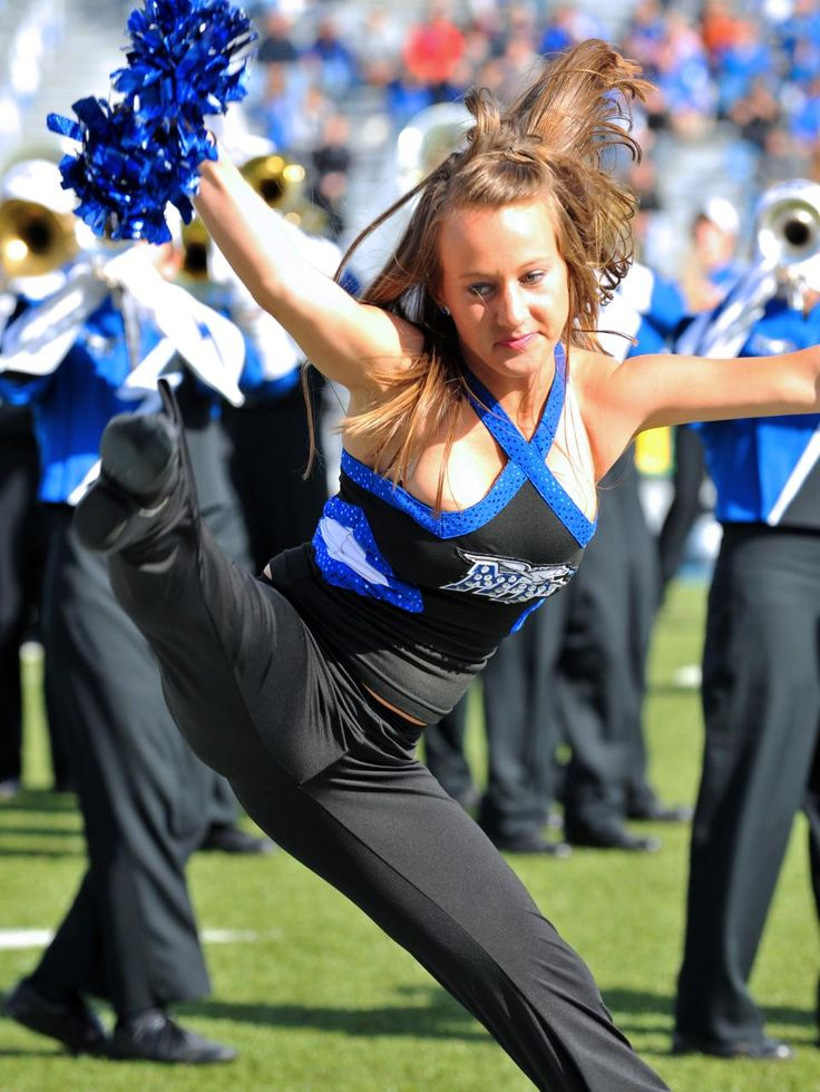 the cheerleader dancing as a sport American football - sport, cheering, cheerleader, dancing, 14-15 years only from istock open comp open comp  dancing, female high school student, fun.