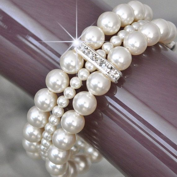 I just bought a bracelet just like this from a Premier Jewelry party...and it was only $22 and Premier's has two more strands!