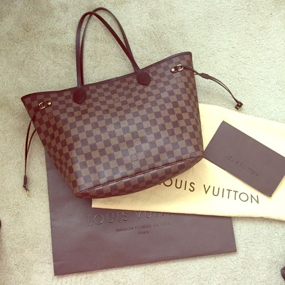 Authentic Louis Vuitton Neverfull MM Damier Ebene Authentic Louis Vuitton Neverfull MM in Damier Ebene. Date code: SD1019. This is the original Neverfull without the separate pouch. Has normal wear on handles and top edge as shown, some rubbing wear at bottom corners. Comes with dust bag and shopping bag. I also have the original receipt. Louis Vuitton Bags Totes