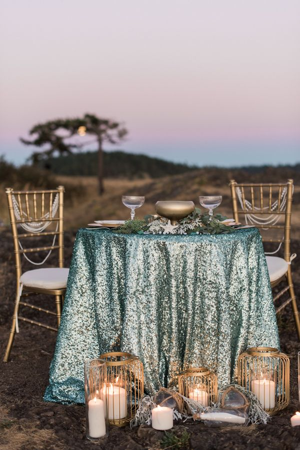 Glam Mermaid Wedding on the Moonlit Coast - Sequin and Candlelight Sweetheart Table in Aqua and Copper | B Jones Photography | http://heyweddinglady.com/glam-mermaid-wedding-moonlit-coast/