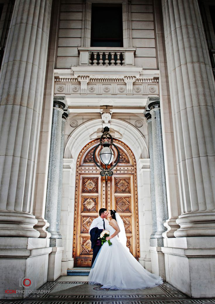 Melbourne City Wedding Location Photos - Bride and Groom sharing a moment in front of the regal Parliament House of Victoria's Entrance Doors. Grandeur and Melbourne City's Finest Architecture. Photography: Con Tsioukis ICON PHOTOGRAPHY MELBOURNE
