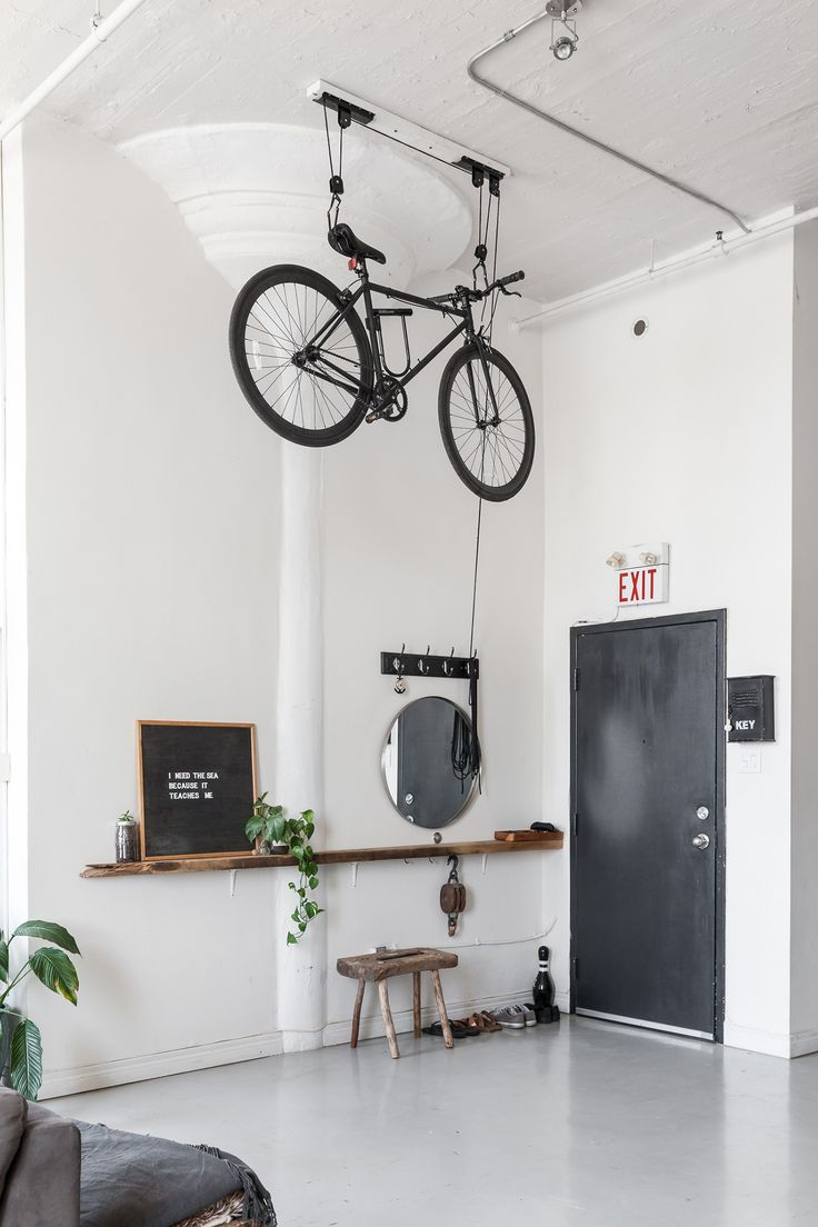Nautical Scandinavian Style in a Bright White Toronto Loft This Toronto apartment's super high ceilings work perfectly for this one-of-a-king bike pulley sy Toronto Lofts, Toronto Apartment, Indoor Bike Storage, Bicycle Storage, Hanging Storage, Bike Storage Pulley System, Bike Storage For Small Spaces, Vertical Storage, Apartment Design