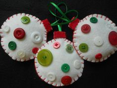 Christmas Ornaments ~ White Felt & Buttons. $18.00, via Etsy: This listing is for a set of 3 white wool blend felt Christmas ornaments. They have been hand cut and hand sewn. Each is decorated with unique red, white & green buttons. No two are alike. They are lightly stuffed with polyester fiber fill and a red satin ribbon hanger is sewn into the top seam for easy hanging. They will stand out on your tree.