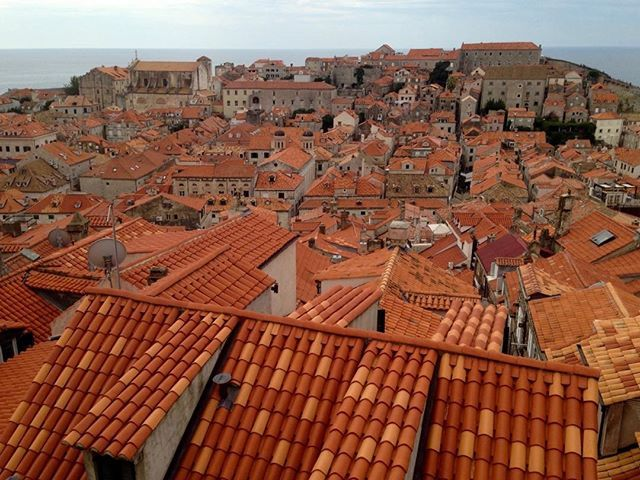 #Townscape Dubrovnik #Croatia Walking high above the Oldtown along the top of the ancient city walls that surround this awesome place - the new and old roof tiles reveal the damage of the war on this in 1991. Not many buildings are left with original red-tiles.