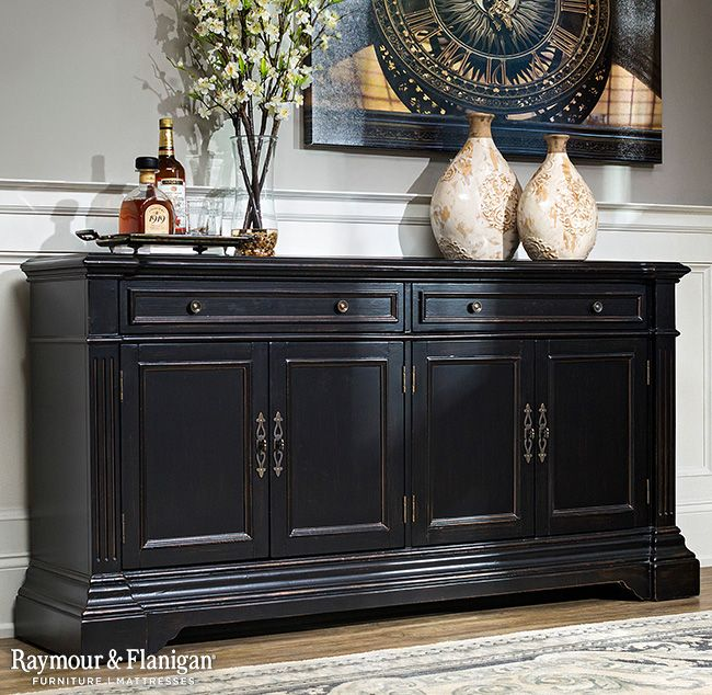 "Create a classically stunning entertainment setup in your living room or den with this new Bronson 68.5"" media credenza. Its black rub finish, antiqued brass hardware and reeded pilasters provide charming traditional style. Plus, wire management cutouts make it easy to keep cords organized."