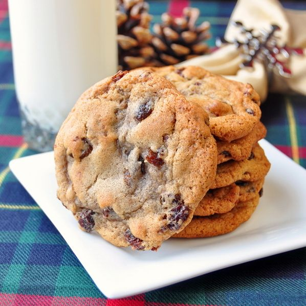 Soft and Chewy Raisin Spice Cookies - The best raisin spice cookie I've ever had. Soft and chewy with crispy edges, these delicious cookies will fill your house with spicy scent as they bake. I hear they are one of Santa's very favorites too.