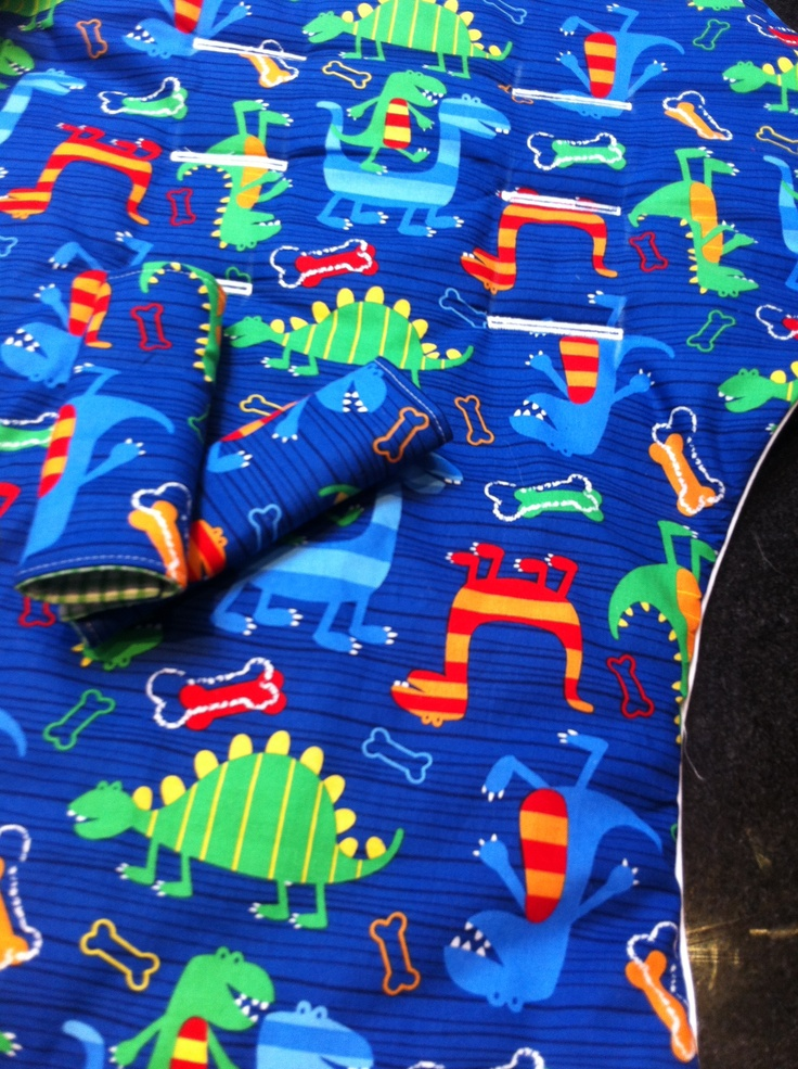 Blue dino pram liner and strap covers