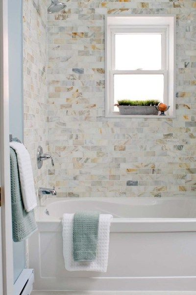 subway tile tub surround with calcutta gold marble tile for the shower with fibreglass tub