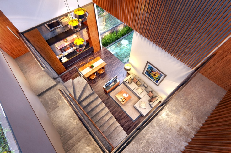 The imposing, 7m high drop from the mezzanine overlooks the living and dining area with a glimpse of the outdoor pool.