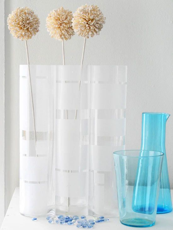 Create sophisticated frosted glass vases by using painter's tape and paint that mimics the look of frosted glass. More budget-friendly DIY projects: http://www.bhg.com/decorating/do-it-yourself/accents/budget-friendly-diy-projects/?socsrc=bhgpin062113vases=13