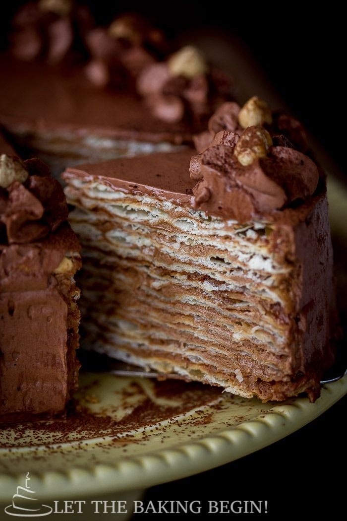 Chocolate Cake Mikado - thin, flaky cake layers that are frosted with chocolate custard buttercream
