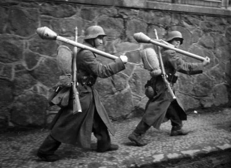 Two young German soldiers armed with panzerfausts and rifles on the move. Lauban (Lubań) Niederschlesien (Lower Silesia) Germany (now Poland). 30 March 1945.