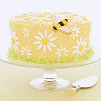 [sorry for the tiny pic, but this site has a recipe for a daisy cake if you want to bake it at home]