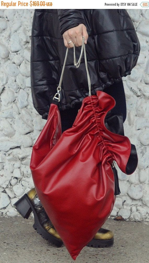 Red burgundy leather bag, easy to wear, very practical and fun. Light as a feather, this handbag will jazz up the streets and will steal the spotlight with the gorgeous mysterious burgundy. Material: 100% genuine leather  Size: Length - 27.5 (70 cm) / Width: 27.5 (70 cm)  The black jacket in the photos: https://www.etsy.com/listing/477937948/extravagant-metallic-black-jacket