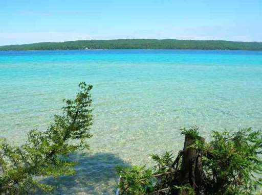 Torch Lake is the longest lake (19 miles long) and second largest lake (18,770 acres) in Michigan. It is 17 miles NE of Traverse City and is separated by land from both Grand Traverse Bay on the NW & Elk Lake at the SW end. Its waters are unusually clear & exhibit a bright turquoise hue, resembling Caribbean waters.  It has a max depth of 285 ft & an average depth of 111 ft, making it Michigan's deepest inland lake. Its famous sandbar.