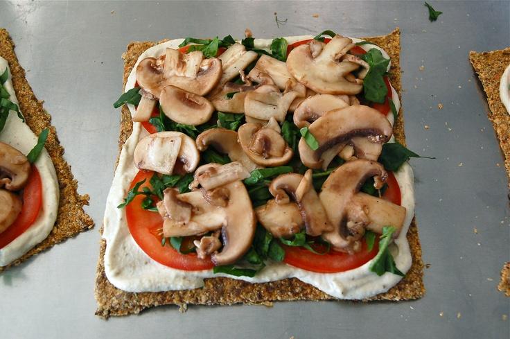 pizza almost done: with tomato, fresh basil, and tamari marinated mushrooms