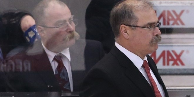 Head Coach Paul MacLean of the Ottawa Senators has a look alike behind the bench against the Florida Panthers during second period of NHL action at Scotiabank Place in Ottawa, January 21, 2013.