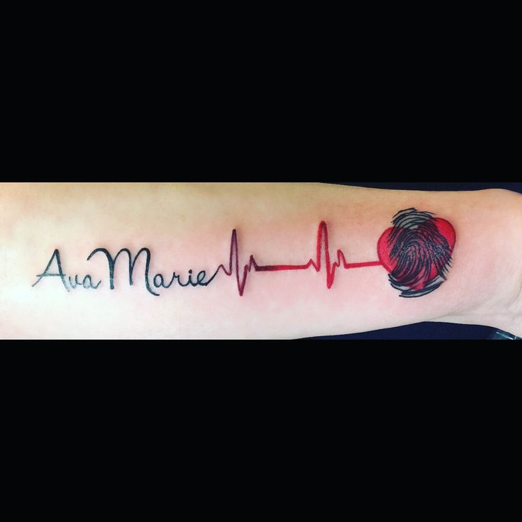Tattoo of daughters name (blackjack font) with heartbeat and her fingerprint in a heart