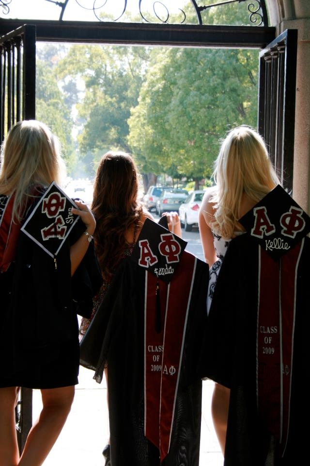 I like this idea. I think i'm going to do a picture of me holding my cap and gown over my shoulder walking out of the stadium after graduation.
