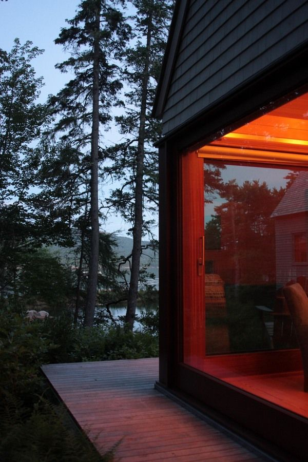 Pond House embracing the Coast of Maine. Maine Coast 'wharf-style' summer home. Elliott + Elliott Architecture.