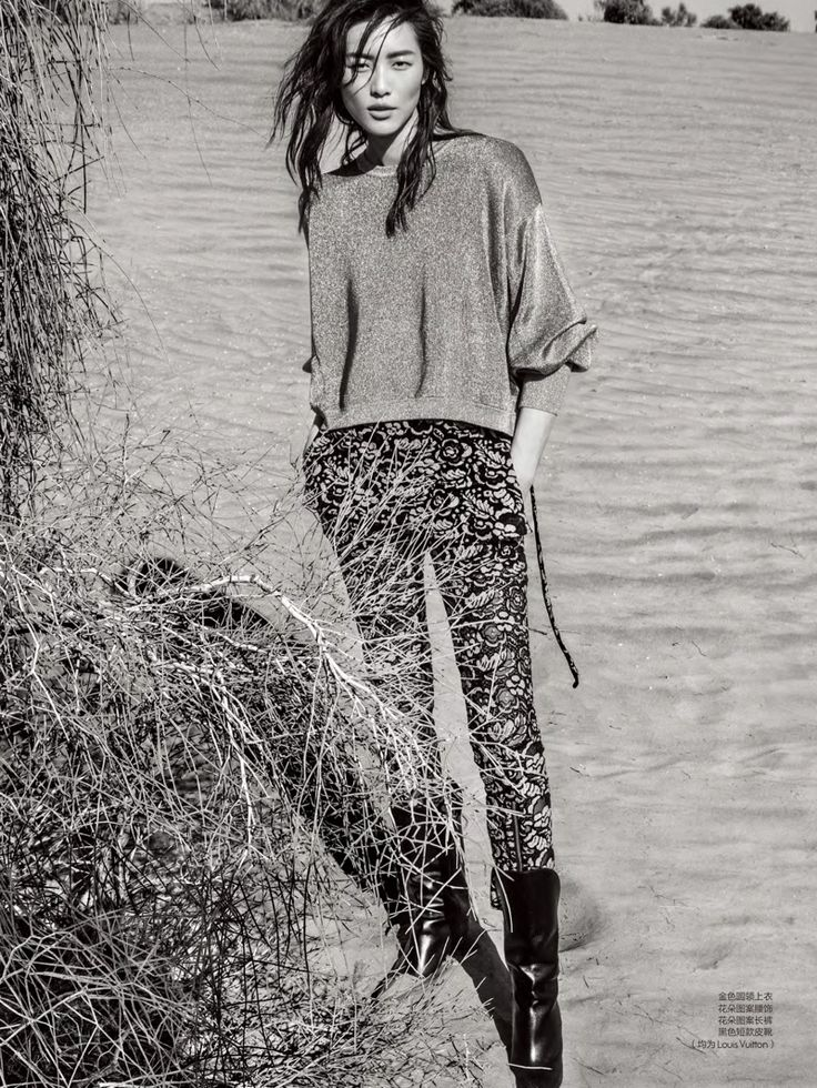 Photographed in black and white, Liu Wen wears Louis Vuitton top, printed pants and boots