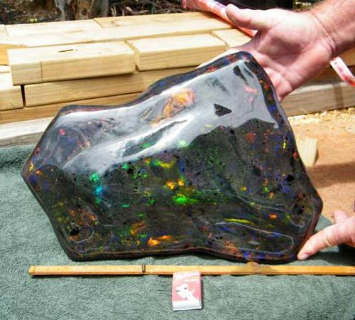 The largest opal matrix stone was found in the outback Opal Fields of South Australia. It weighs in at an amazing 55,000 carats. The length is about 30cm, height varies from 15-20cm and it's around 4cm thick.