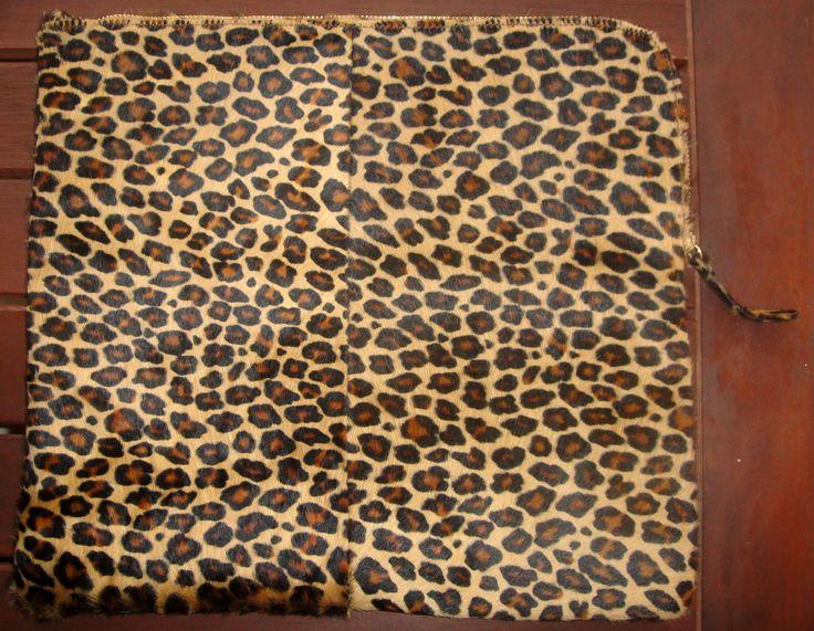 Pony hair leather clutch byCACHE
