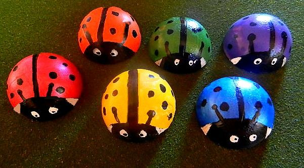 Easy ideas for pops of color in your garden when you don't have a green thumb.I love adding a sense of the unexpected in my garden and these little lady bugs are perfect. They were created using an old tennis ball that I cut in half and a little bit of Portland Cement. Once dried they popped out of the tennis ball easily (it got easier and easier each time I used the same ball). I then spray painted them, added the details and sealed the paint with some outdoor spray sealant.